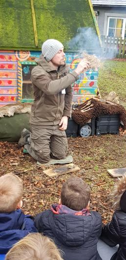 Rob lit a fire using flint stones.