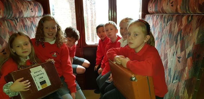 Looking sad, being evaucated, in 2nd class.
