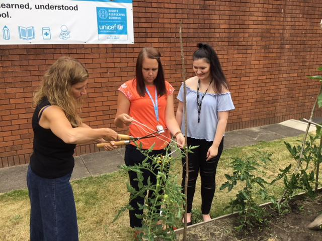 Miss Lang, Ms Sage and Georgia get stuck in!