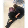 K tells Ms S to put Mrs E in the recovery position