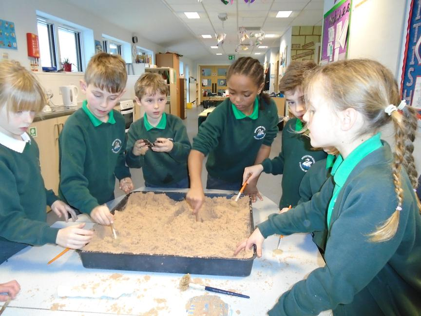 Archaeologists digging for artefacts