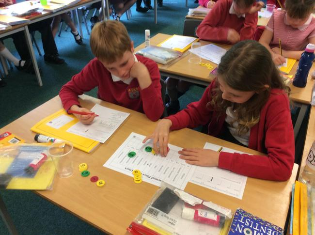 Year 4 had a very interesting maths session using place value counters. Look at how amazing we are! 1