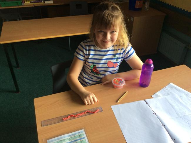 Millie creating her own decomposer minibeast