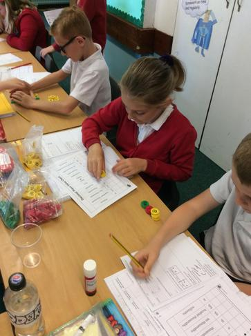 Year 4 had a very interesting maths session using place value counters. Look at how amazing we are! 5