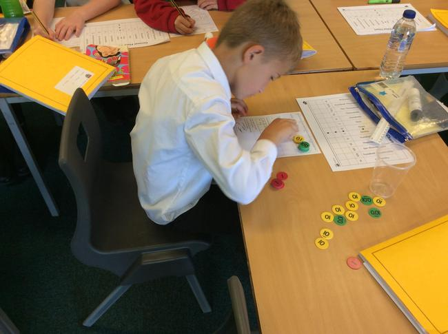 Year 4 had a very interesting maths session using place value counters. Look at how amazing we are! 2