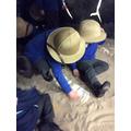 Digging for dinosaur bones.