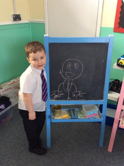 We drew the Gingerbread man on our chalk boards