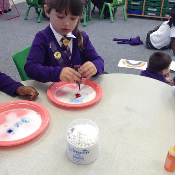 Then we added drops of food colouring...