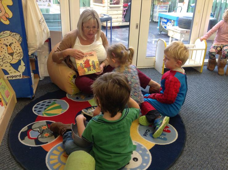 The children listen to the story Harvest Time
