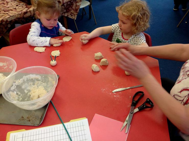 The children make caterpillars from salt dough
