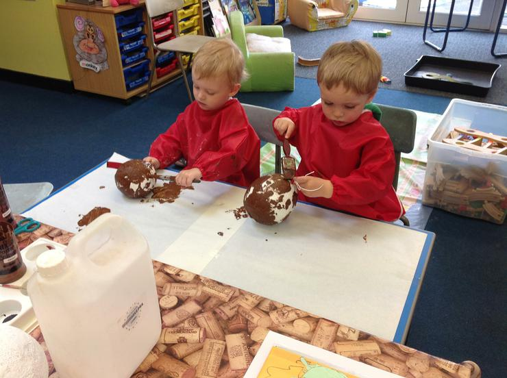 The children paint the homes brown