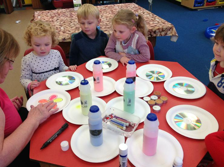 The children make candles using CD disks
