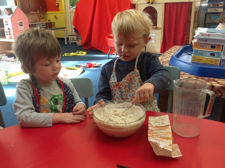 The children take turns to stir