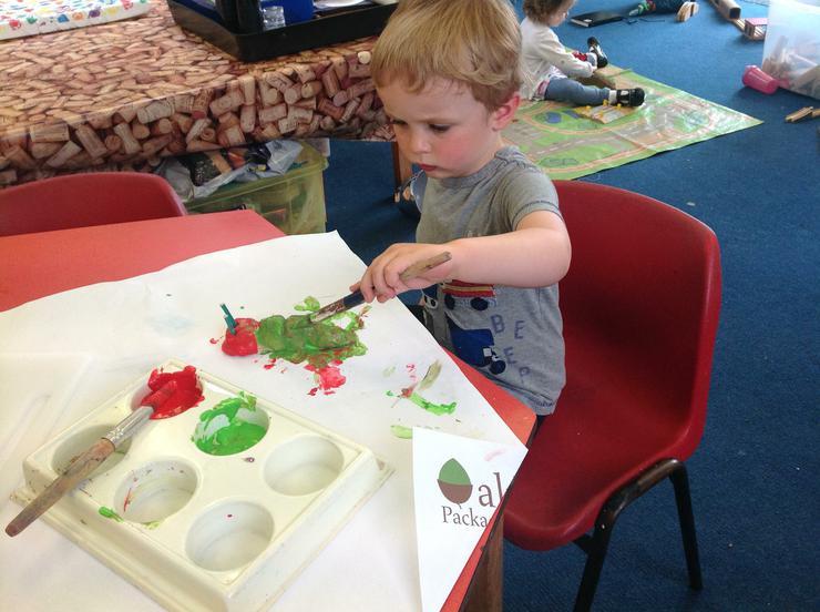 Seth paints his caterpillar
