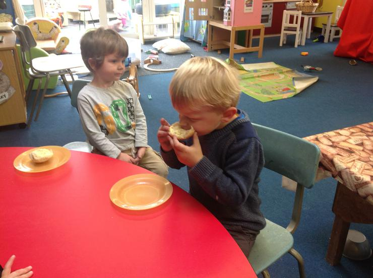Zac enjoys eating his bread roll