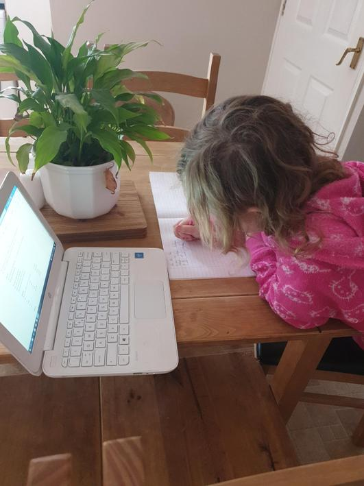 Olivia completing her writing task