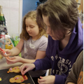 Eva baking with her sister