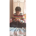 Ashwin getting creative and knitting