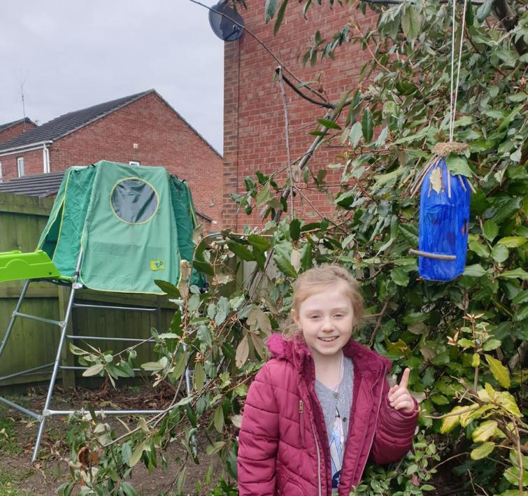 She has made a bird feeder and house.
