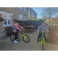 Cool kids wear lids!  Daniel on his bike.