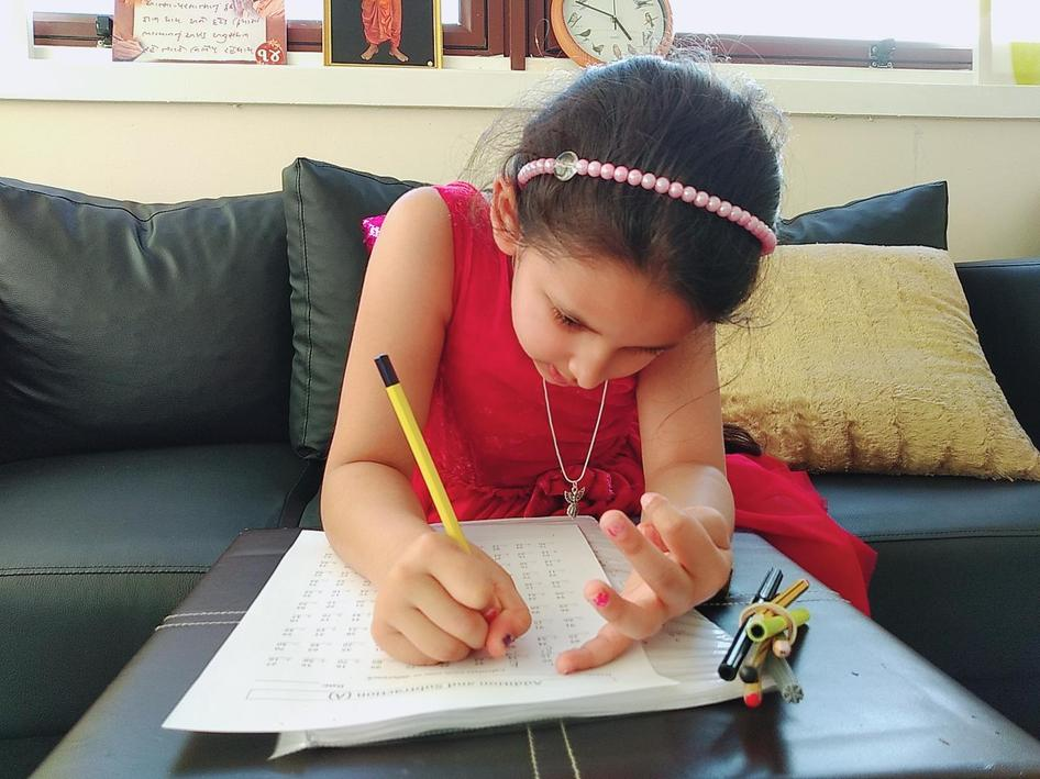 Angel is keeping busy by completing her maths work