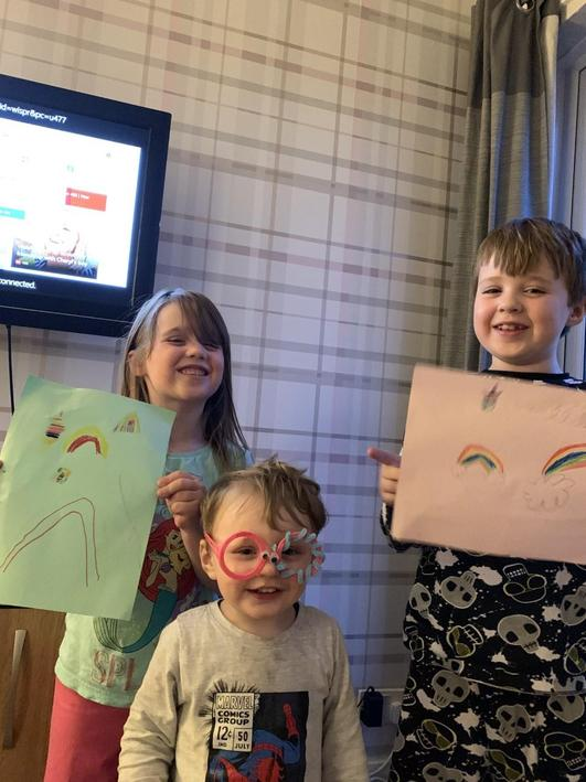Oliver and his family have been drawing rainbows.