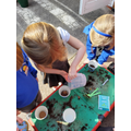 Preparing pots for our seeds
