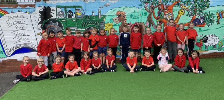 A lovely picture of our class stood in front of one of our new murals.