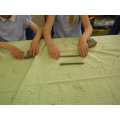 We used our hands and the table to make the shape.
