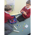 Tommy and Riley making a 'moon buggy'.