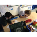 Recording their pulse rate in a table.