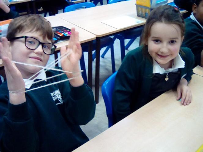 Learning to play cat's cradle. Thinking about the right of children to be able to play.