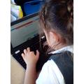 Practising keyboard skills.