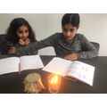Hibah and Nabeelah studying science!
