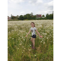 Imogen exercising in the daisy field