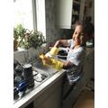 Practising life skills - washing up.
