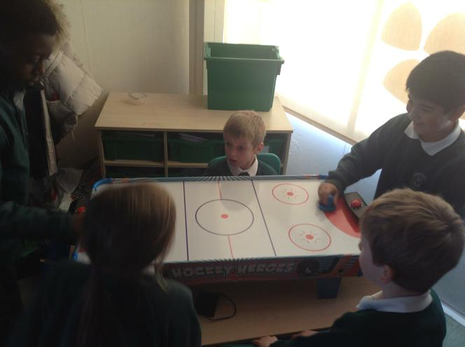 Enjoying our new air hockey game!