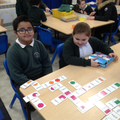 Playing fraction dominoes.