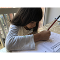 Zahra working on her maths