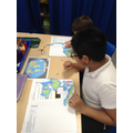 Using a world map to complete a jigsaw.