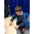 Building a triangular structure.