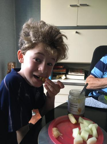 Oscar celebrating Rosh Hashanah. Eating apple and honey to welcome in the New Year.