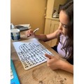Evie working on her times tables!