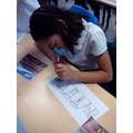 Mixing colours and painting using dots to recreate a photo of Stonehenge.