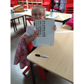 Evie working hard on number bonds