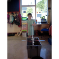 Measuring the height to pour the water from.