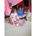 Isabell reading her sister a story