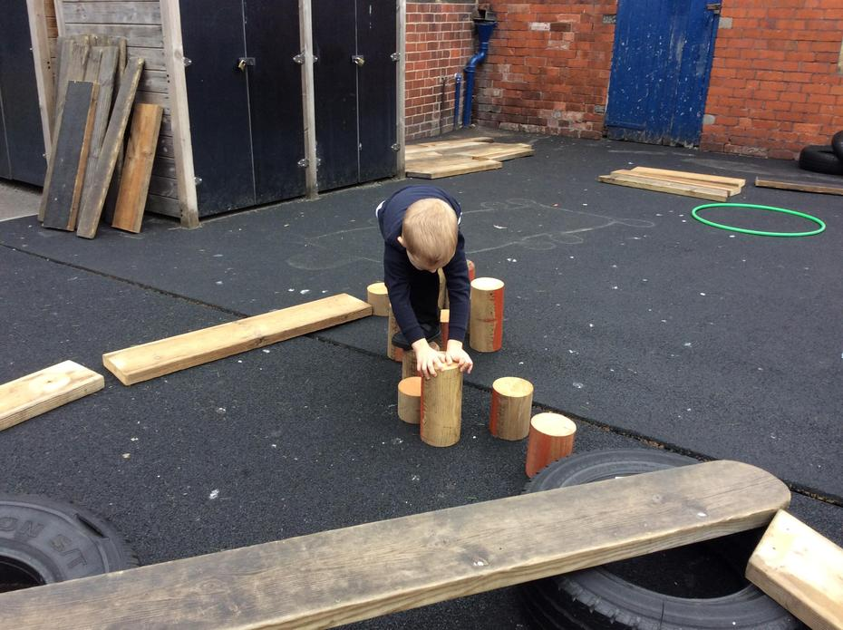 Placing the wooden posts to balance across.