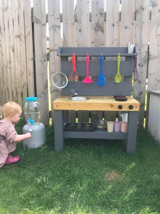Ivy's Nanna and Grandad made her a mud kitchen!