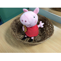Is Peppa Pig on, or in the basket?
